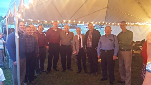 Pastor with preachers at a tent revival